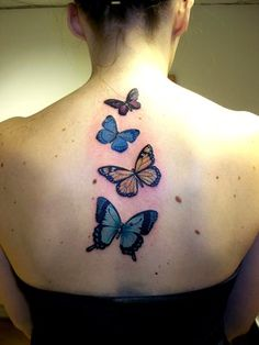 Butterfly tattoo on spine / back