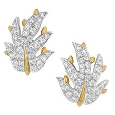 Pair of Platinum, Gold and Diamond Leaf Earclips, Tiffany & Co., Schlumberger   18 kt., the platinum leaves pave-set with 62 round diamonds approximately 1.50 cts., centering polished gold veins, signed Tiffany & Co., Schlumberger Studios, approximately 8 dwts. With signed box.