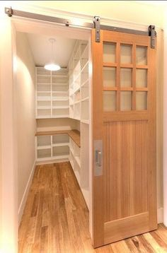 7 ways to create pantry and kitchen storage, closet, kitchen design, shelving ideas, storage ideas, For awkward spaces a barn door could solve your open door problems