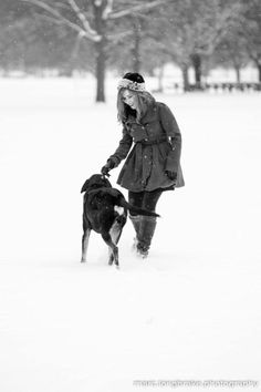 snowy portrait shoot with girl and dog lifestyle photography fun snow black and white color winter senior