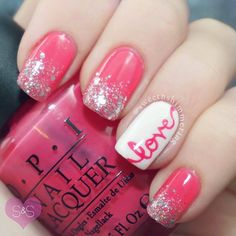"Pink and glittery Valentine's Day nails with ""love"" accent nail."