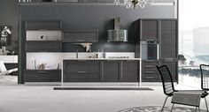Malibù in laminato rovere grigio.  #stosacucine #kitchens #homeinspiration #interiordesign