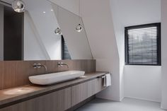 Bathroom Design Idea - Extra Large Sinks Or Trough Sinks   The long rounded trough sink gives this bathroom a stylish and sophisticated look.