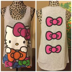 """Hello Kitty Bow Back Tank by Mighty Fine -- Medium Hello Kitty Bow Back Tank by Mighty Fine -- Medium --- 60% cotton 40% polyester ---  26"""" length --- 19"""" bust --- good used condition --- no imperfections  --- thank you for visiting my boutique, please feel free to ask any questions Mighty Fine Tops Tank Tops"""