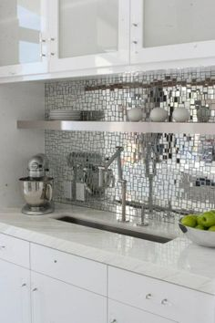 Love this mirrored backsplash! Ideas for the kitchen... Adding anything reflective to a small dark space immediately expands the space in addition to adding more light!