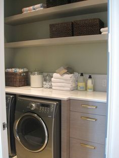 Long, narrow laundry room with large amount of counter space and storage