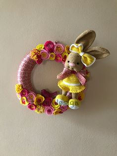 Bunny Wreath. Felt Flowers Wreath This is a wreath with handmade felt flowers and crocheted bunny. Beautiful decor for spring or Easter. Around 35 cm and little more. Price is 35€ plus shipping. The wreath is not sutaible outdoor.