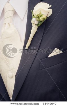 white boutonniere with pearls; tone on tone tie w/shirt
