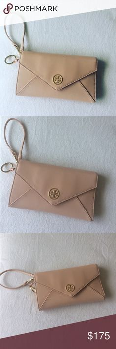 New! Tory Burch Wallet! Beautiful nude wallet with gold tone accents. Never used, gold pen included. Authentic, Nordstrom purchase. Nice and spacious, perfect for an everyday use! Tory Burch Bags Wallets