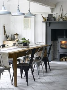 Three small rooms at the back of the house were knocked into one large open-plan kitchen-diner with french doors leading out to the garden. The tongue-and-groove panelling is painted in Little Greene's Shirting (http://littlegreene.com), while the fireplace is in Farrow & Ball's Down Pipe (http://farrow-ball.com). For a similar table try The French House (http://thefrenchhouse.co.uk). Simon found the vintage Tolix chairs on Ebay; they are available new from Made In Design (http:/
