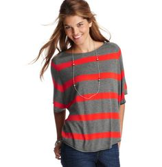 Such a cool sweater. The stripes are sporty, the feel is so soft, and the trapeze shape is super-skinnifying over skinny jeans and slouchy-cool with just the front tucked into a low-slung pleated skirt. Love!!
