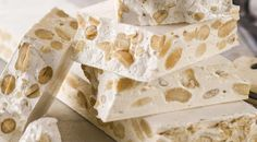 Torrone is a very simple nougat candy made from egg whites, honey, nuts (usually almonds) and –in some recipes– cane sugar. The recipes of several popular commercial candy bars (Toblerone, Mars, etc. Italian Cookie Recipes, Italian Cookies, Italian Desserts, Italian Foods, Italian Biscuits, Candy Recipes, Dessert Recipes, Italian Candy, Italian Christmas Cookies