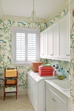 Laundry Room with fun tropical wallpaper & chandelier