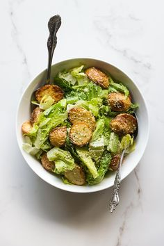 Roasted potato caesar salad with a creamy vegan hemp seed dressing. A gluten free, plant based version of a classic caesar salad.