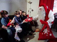 Santa Claus visiting an appartment of Santa Claus Holiday Village With Gifts