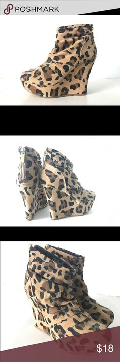 GoJane Leopard Wedge Booties, size 5.5 Purchased from GoJane. Leopard wedge booties, size 5.5.  Zipper on the back. Comfortable and stylish: goes with a dress or even a pair of jeans/leggings.  Has a cute pleated detail.  Never worn! 😊 Shoes Ankle Boots & Booties