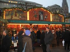 A gingerbread and lebkuchen stall with an elaborate facade at the Hamburg Christmas market.