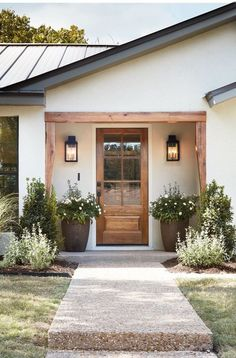 front door inspiration wood front door with big windows home decor inspiration entryway landscaping inspiration Style At Home, Pintura Exterior, Wood Front Doors, Front Door Plants, Farmhouse Front Doors, Planters For Front Porch, Front Porch Lights, Big Planters, Privacy Glass Front Door