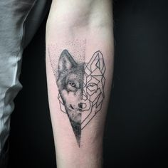 Geometric wolf on forearm