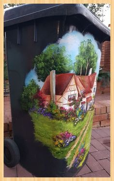 Homeowner updates boring trash can—look at how amazing it is now!