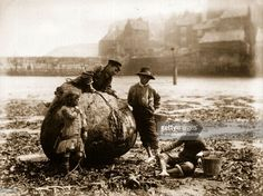 Mudlarks, children who beachcomb for waste materials to resell, on Tate Hill Sands, Whitby, North Yorkshire.