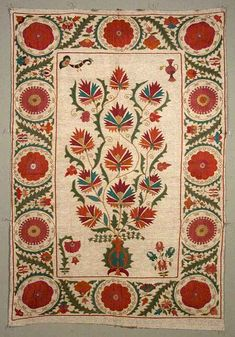 Taskent Suzani. Fine Bukhara couching and chain stitch embroidery in a contemporary suzani (Uzbekistan)