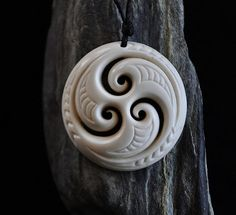 Handcarved in Bone. Trinity koru for Family & Unity with Earth,Sea and Sky
