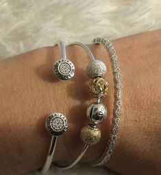 3 beautiful Pandora bangles. Essence bangle with mixed metals charms. Gifted to me on my 50th, from my 2 wonderful kids. | Pandora | Pinterest | Pandora bangle