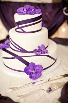 Wedding Cake.  Love the asymmetrical ribbon, different color and flowers