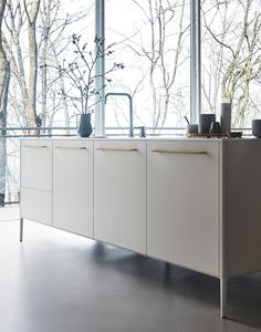 Cesar Modern Unit kitchen in white silk lacquer finish with Hanex white solid surface countertop. Isn't it time to ask how our award winning designers can help you achieve the kitchen of your dreams? #remodeling #renovation #construction #remodel #interiordesign #design