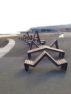 Bespoke seats & benches on Colwyn Bay promenade, made from 316 marine grade stainless steel and kebony syp timbers