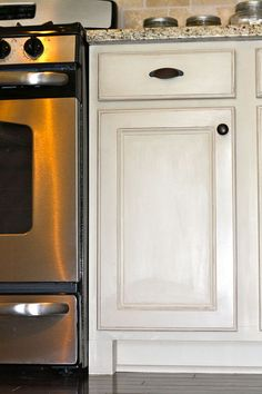 chalk painted kitchen cabinets, chalk paint, doors, home decor, kitchen cabinets, kitchen design, ASCP in Old White with Clear Wax and distressing
