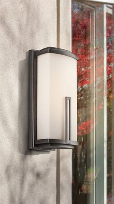 Cool contemporary shapes, traditional forms and updated detailing work in tandem to create the stylish look of the Kichler Leeds collection Exterior Wall Light, Exterior Lighting, Antique Pewter, Landscape Lighting, Outdoor Walls, Leeds, Candle Sconces, Wall Lights, Glow
