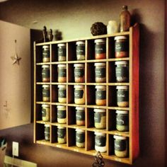 Spice rack. Pottery barn rack with mason jars covered in chalkboard paint on the front. Fill with your favorite spices and enjoy!