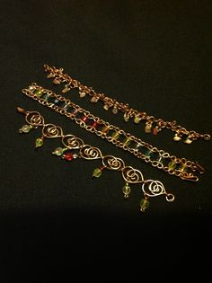 Three of my handmade copper wire and glass bead bracelets