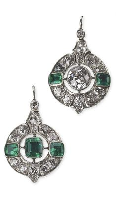 A pair of Art Deco platinum, gold, diamond and emerald earrings.