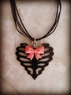 Heart-shaped ribcage with bow love it but the bow should be blue or red