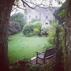 Big old stone house, large yard with garden bench