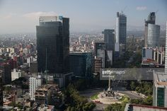 Buildings with construction cranes stand behind the Angel of Independence monument on Reforma Avenue in Mexico City, Mexico, on Tuesday, Dec. 9, 2014. Stock prices for some of Mexico's biggest and engineering companies have fallen since the government scrapped a $4.3 billion rail award last month, stoking worries that future infrastructure spending would face greater scrutiny, according to Invex Casa de Bolsa. Photographer: Susana Gonzalez/Bloomberg via Getty Images