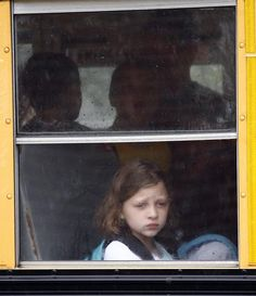 Third grader Sophia Guilbeault looks out at the rain on her way to the first day of classes at North Pembroke Elementary School on Tuesday, Aug. 28, 2012. Greg Derr/The Patriot Ledger