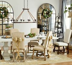Two statement-making Grand Palais Mirrors create the illusion of windows in this gorgeous dining room.