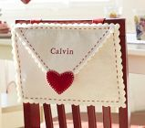 Personalized Valentine Mailbox for Chair (Directions: Cut 2 rectangles & 1 triangle out of felt. Sew the base of the triangle to the base of 1 rectangle so they overlap to create a flap. Lift flap & place the other rectangle between the rectangle & triangle. Sew the 3 sides of the triangles together than are not covered by the triangle flap.)
