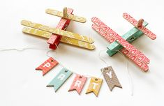 Airplanes and banner with popsicle sticks (refrigerator magnets)