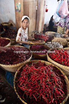 selling peppers at the market, Mataram village market, Lombok island, Indonesia | Setboun Photo