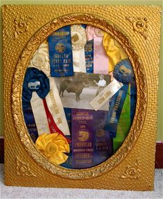 In a garage sale frame, I pinned my Great Grandparent's champion ribbons from showing cattle and pulling horses in the 1940's....It's A Family Tradition.