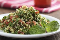 Traditional tabouli with cracked bulgar wheat, tons of parsley, diced tomatoes, and the ever-present Mediterranean essential - olive oil!