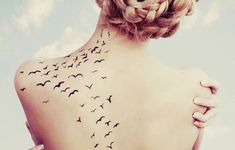 bird flying tattoo on back