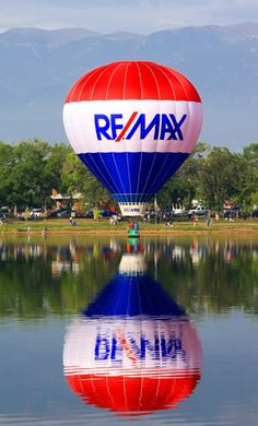 The ReMax Real Estate hot air balloon dipping into Prospect Lake, Memorial Park, Colorado Springs, CO.   #remaxballoon