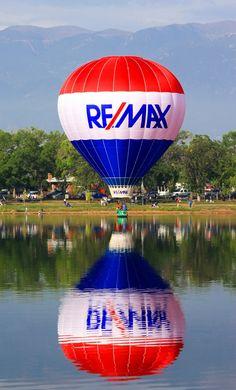 The ReMax Real Estate hot air balloon dipping into Prospect Lake, Memorial Park, Colorado Springs, CO.   #remaxballoon