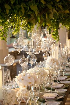 Re-create this same look at your own wedding or special event using our Glass Globe Candle Holders found here: http://www.lightsforalloccasions.com/p-2820-candle-holder-round-glass-globe-hanging-or-table-top-3-inch-6-pack.aspx #candle #orb #candlelight